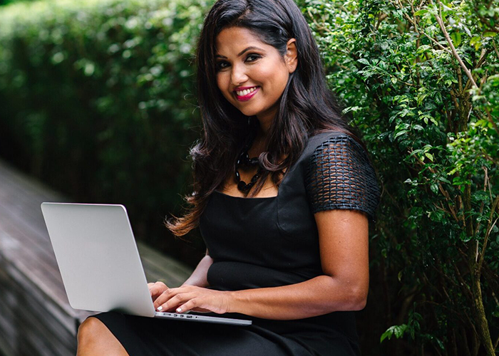 female real estate agent working on laptop