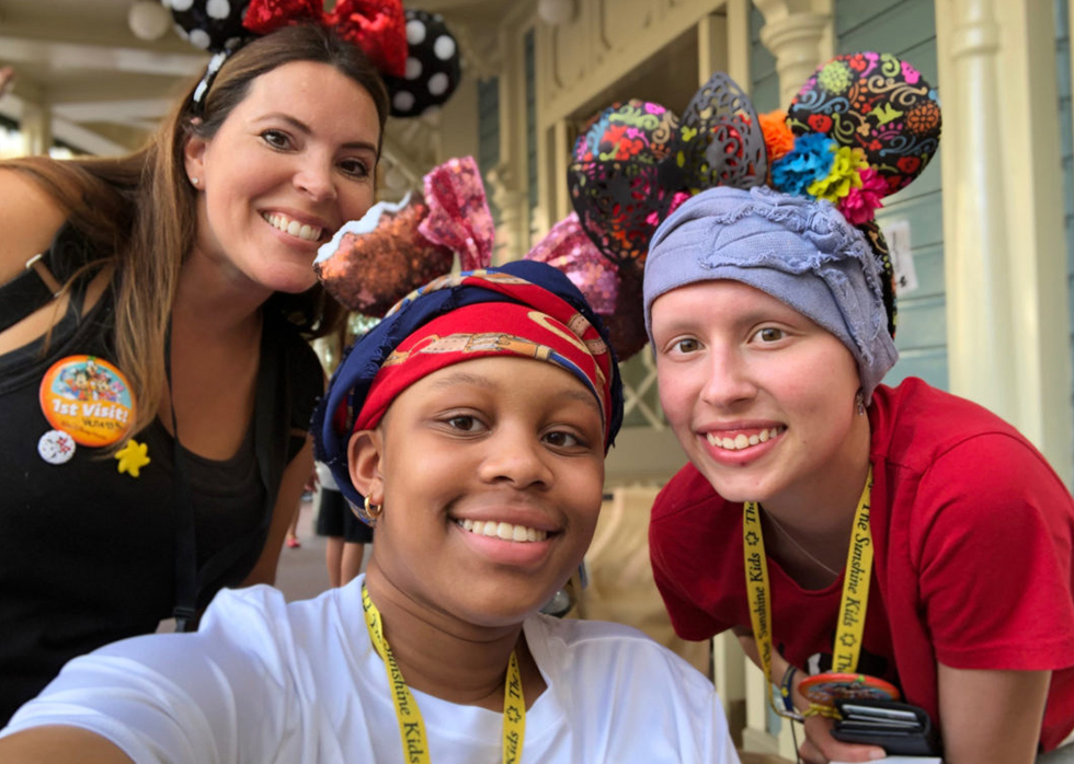 two Sunshine Kids with a volunteer during annual Orlando trip to theme parks