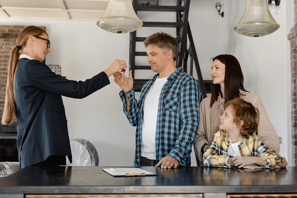 homeowners receiving the keys to their next home