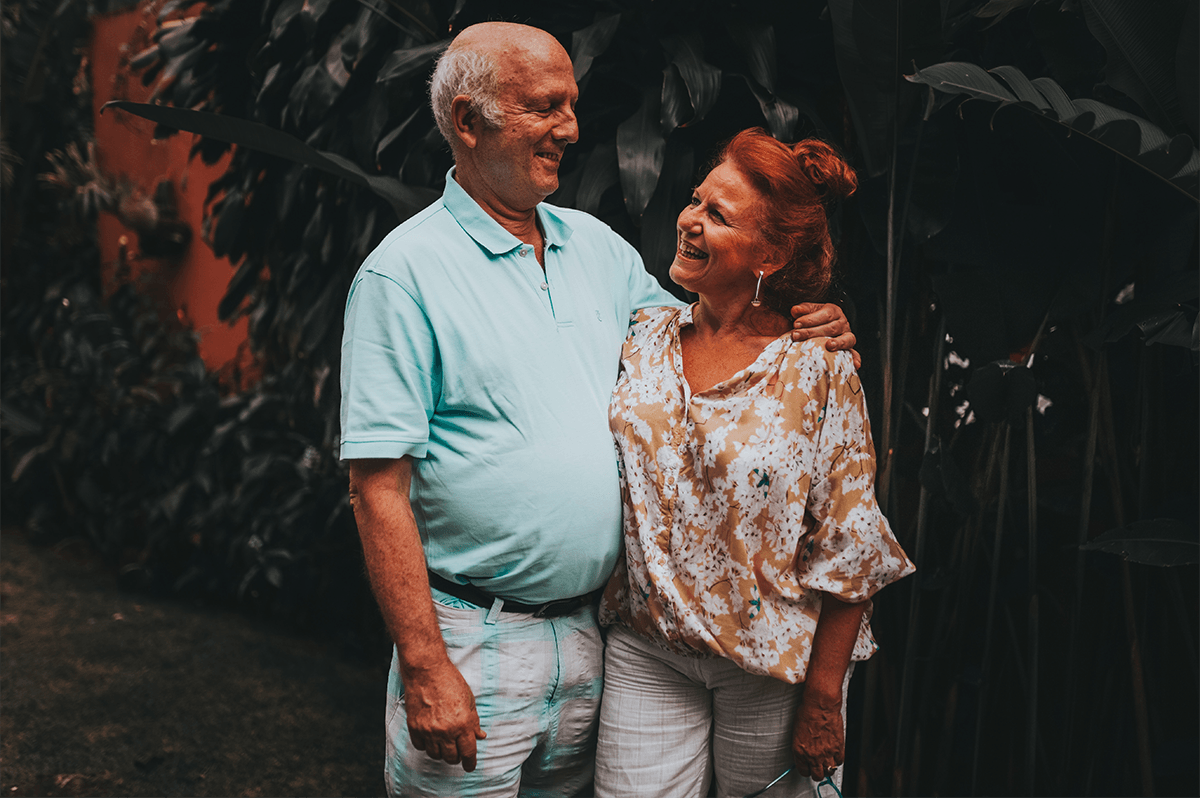 senior couple smiling after the sale of their home