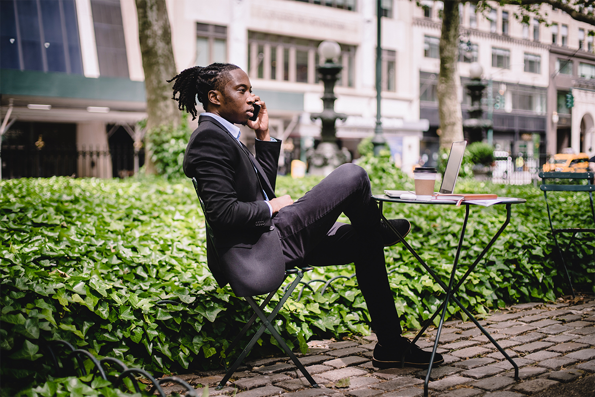 commercial real estate agent on a phone call sitting outdoors