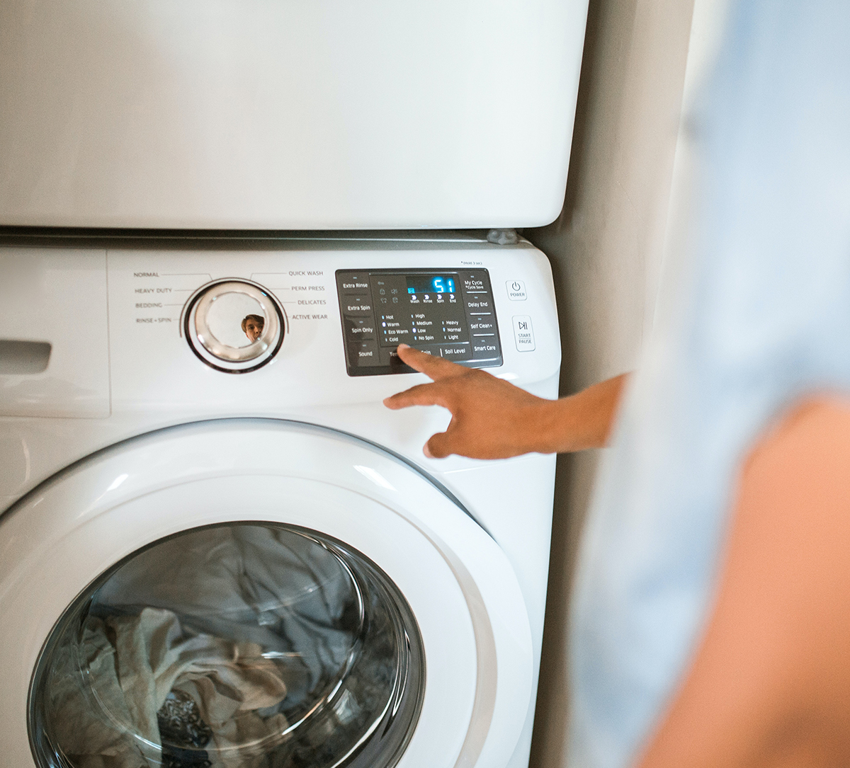 Home owner using their washing machine