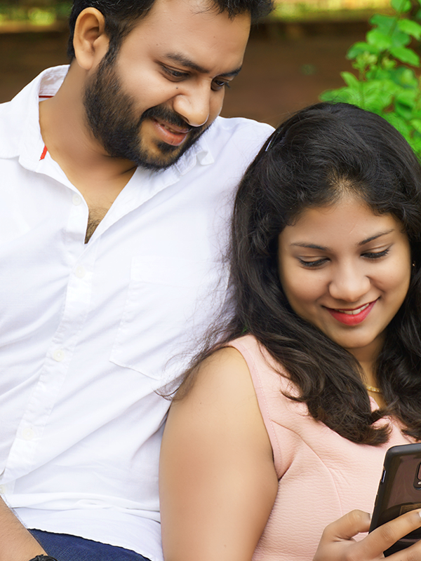 couple looking at real estate on mobile phone