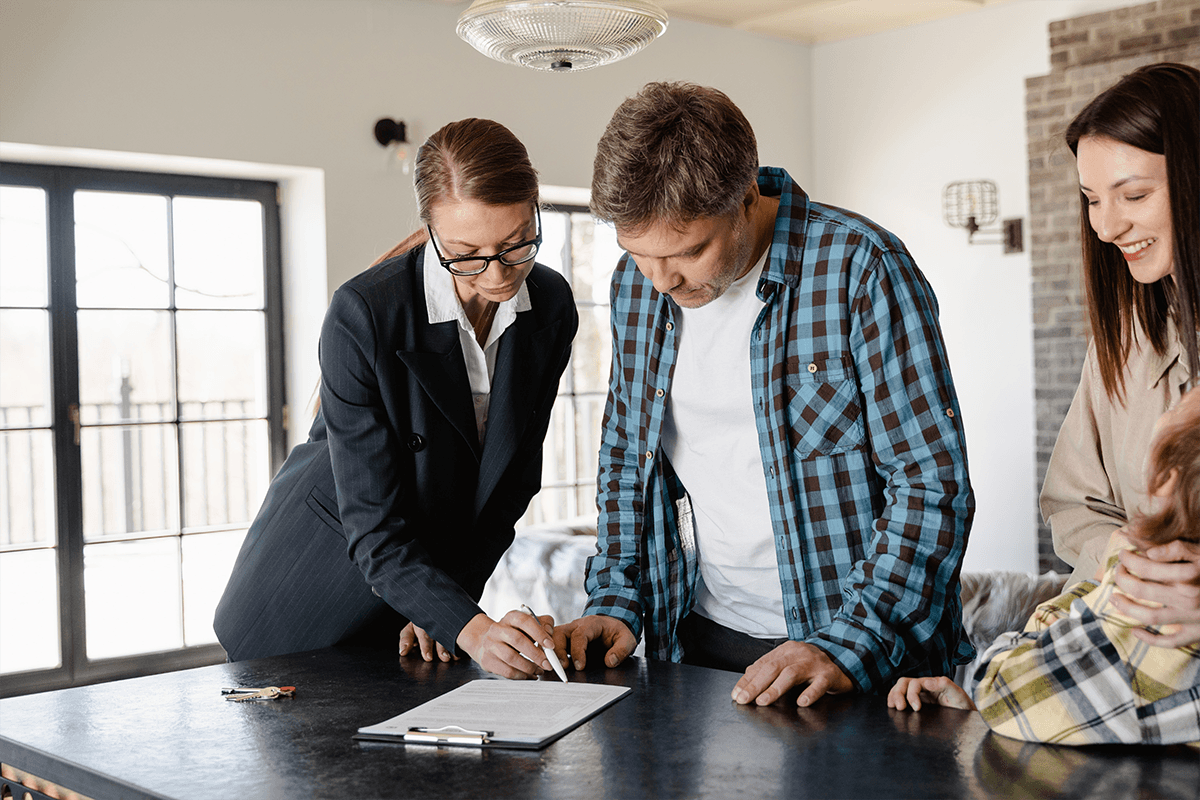 property manager reviewing lease with renters