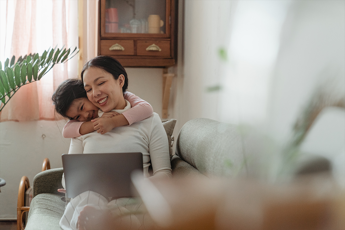 woman and child looking an homes to rent on laptop