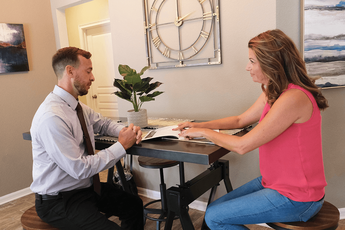 real estate agent discussing market trends with client