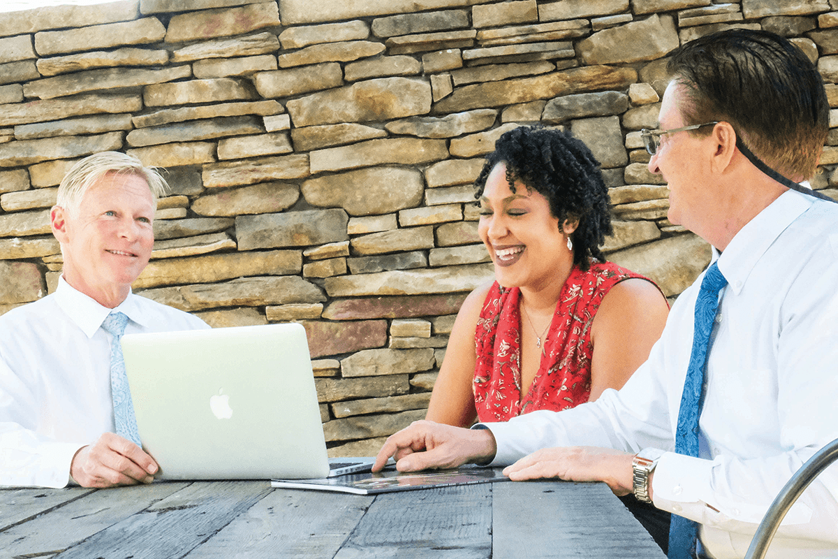 realtors consulting with a homeowner on the sale of her home