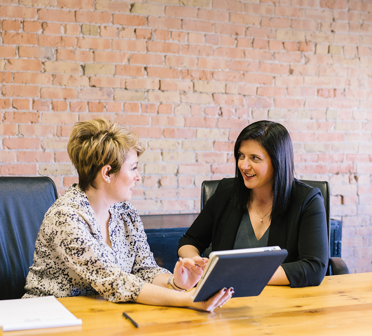 title agent working with a buyer at the closing table